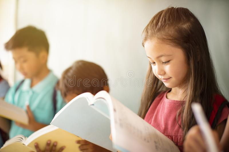 diverse young students studying in  classroom royalty free stock photo