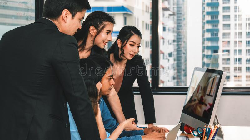 Group of diversity business people having business discussion while watching presentation on computer screen stock photos