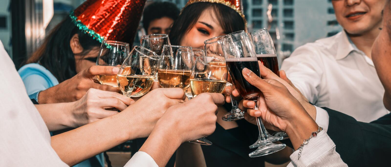 Group of diversity business people having fun and having wine glass toasting together in corporate new year and Christmas party royalty free stock photo