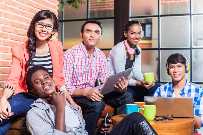 Group of diversity college students learning on campus royalty free stock photo