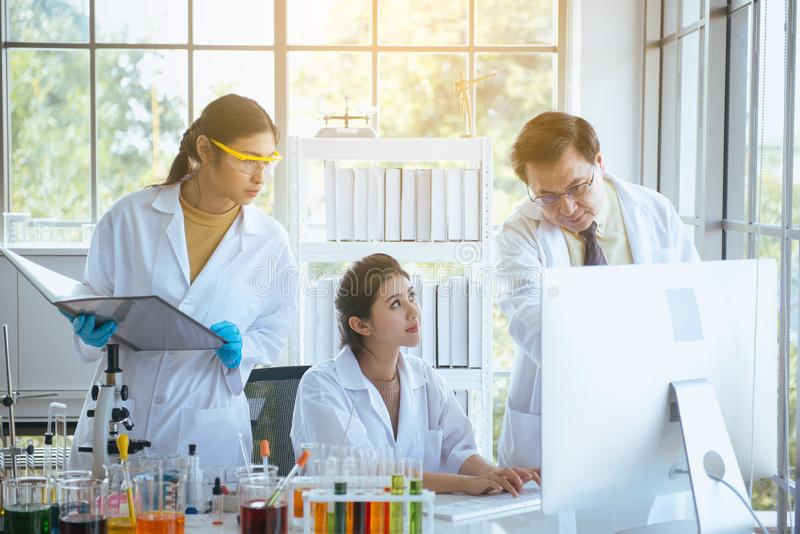Group of diversity medical student research new project at laboratory with professor together royalty free stock image