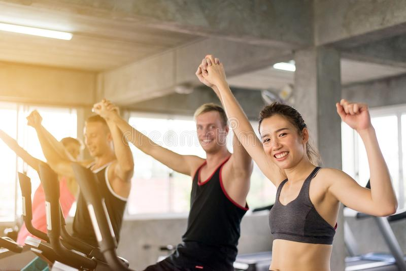 Group of diversity people hand rais up for motivation,Sporty young friendly team happy and attractive together. Group of diversity people hands rais up for royalty free stock photography
