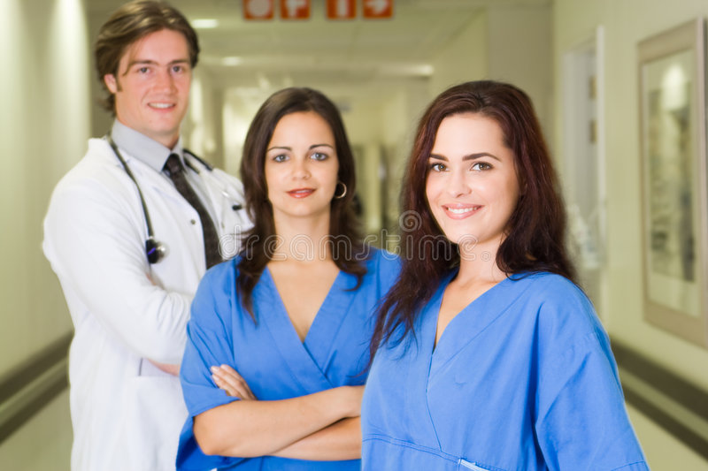 Group doctors. Group portrait of doctors and nurses in hospital hallway royalty free stock photo