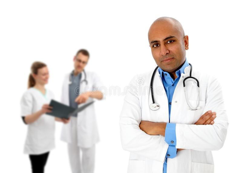 Group of doctors with african stock image