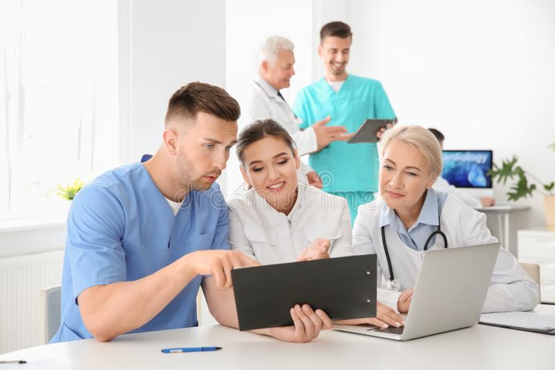 Group of doctors attending meeting in clinic. Cardiology conference royalty free stock photography