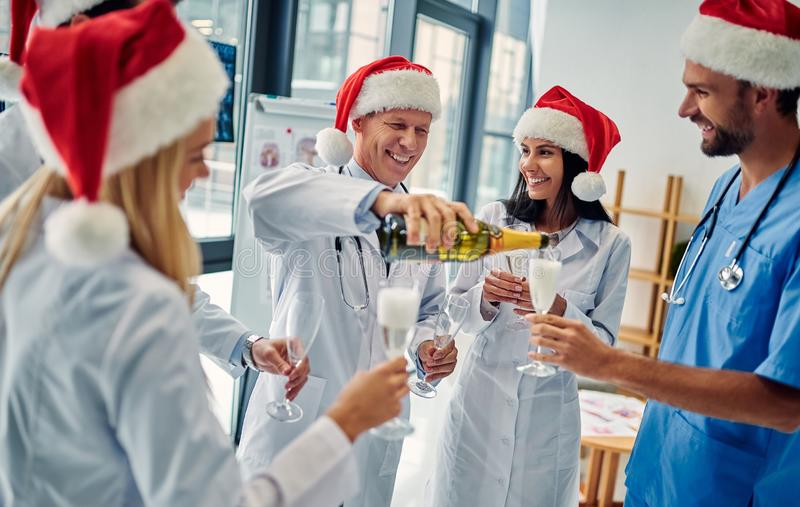 Group of doctors celebrating Christmas royalty free stock photography