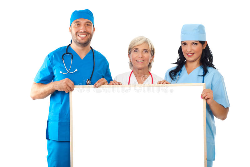 Group of doctors holding banner. Happy group of doctors holding blank banner isolated on white background,check also stock images