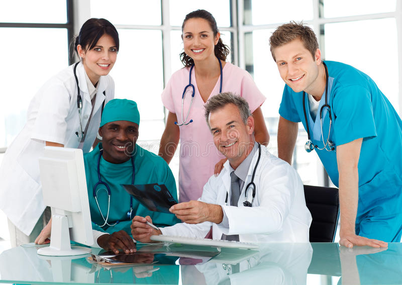 Group of doctors in a meeting stock photos