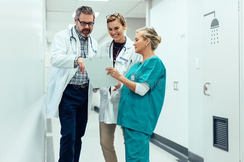 Team of doctors working on patients file at hospital royalty free stock photos