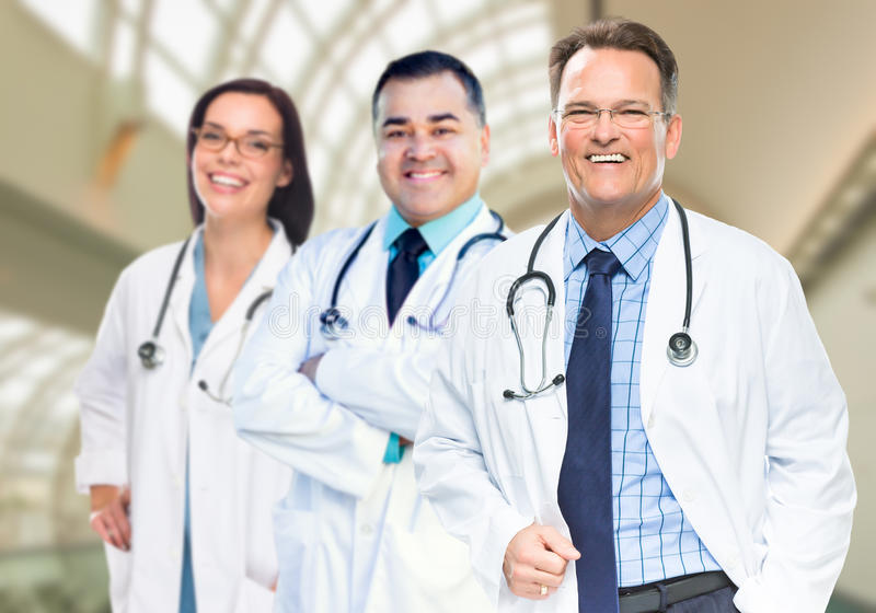 Group of Doctors or Nurses Inside Hospital Building. Group of Male and Female Doctors or Nurses Standing Inside Hospital Building stock photography