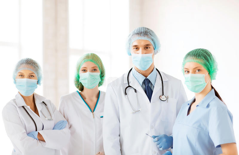 Download Group Of Doctors In Operating Room Stock Photo - Image: 32588384