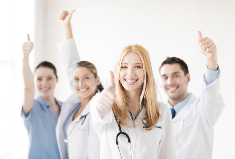 Group of doctors showing thumbs up stock images