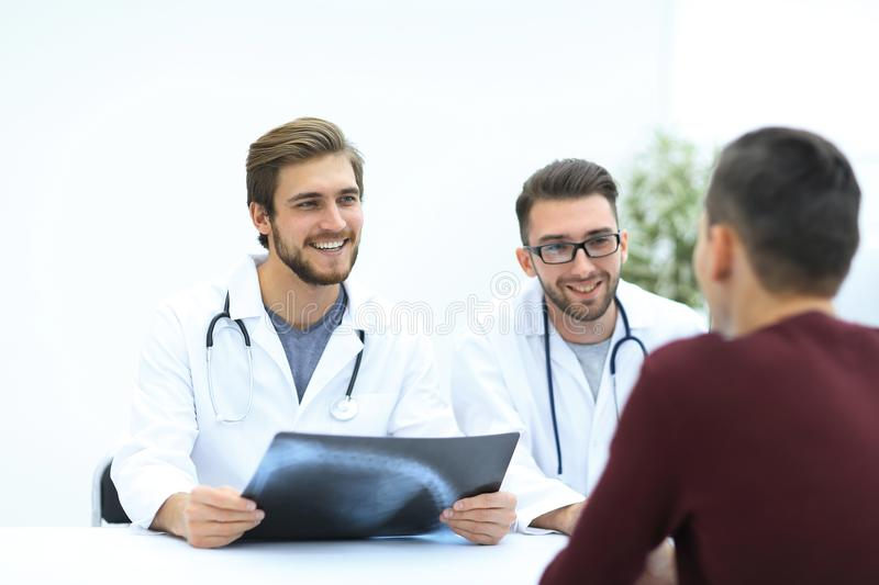 Group of doctors welcoming their customer with a handshake stock images