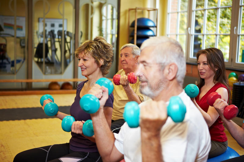 Group Doing Dumbbell Exercises Stock Photos