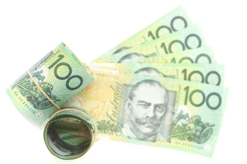 Group of 100 dollar Australian focus at roll notes and blur expand notes on white background royalty free stock image