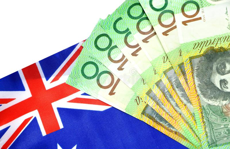 Group of 100 dollar Australian notes expand on Australia flag royalty free stock photo