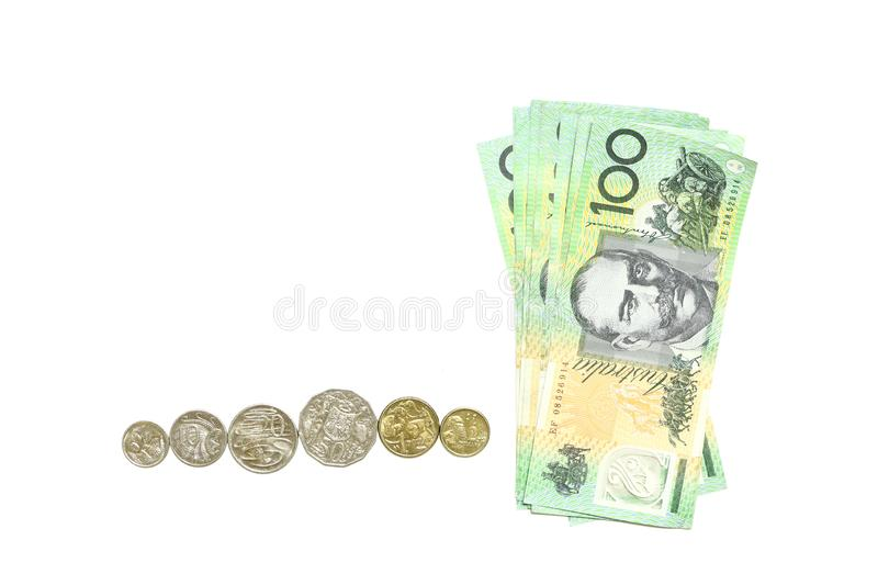 Group of 100 dollar Australian notes and many coins aud on white background. Group of 100 dollar Australian notes and many coins aud isolated on white background royalty free stock photos
