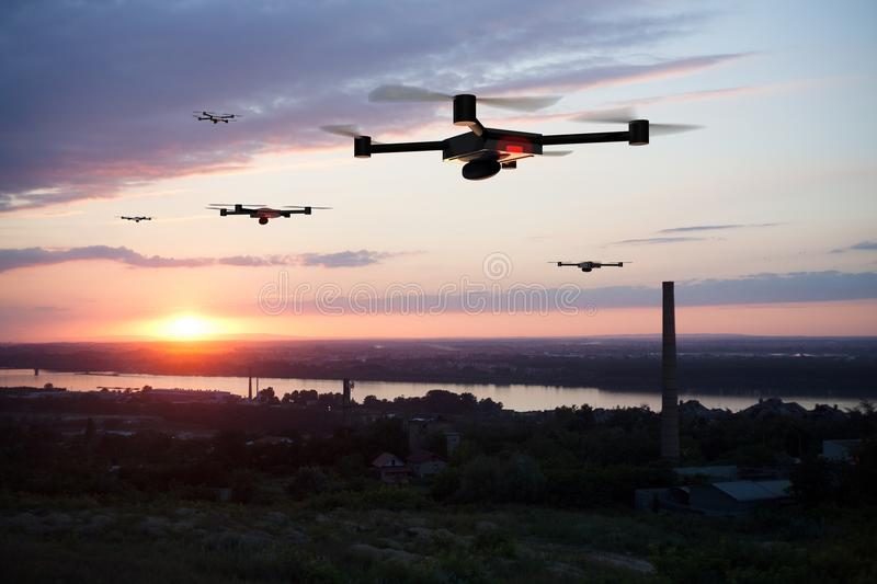Group of drones above the city. Group of drones approaching the city