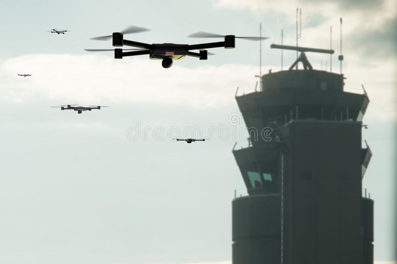 Group of drones approaching the airport control tower. Group of drones and the airport control tower royalty free stock images
