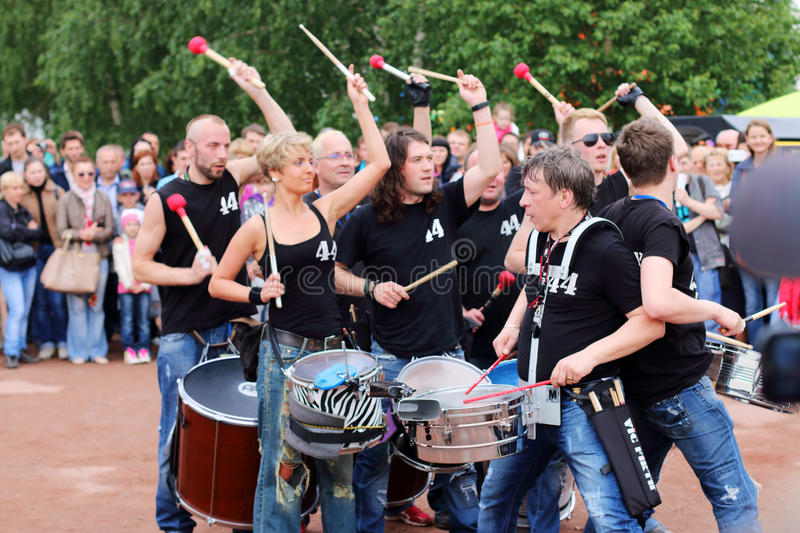 Group of drummers 44 Drums perform at open air festival White Nights. PERM, RUSSIA - JUN 15, 2014: Group of drummers 44 Drums perform at open air festival White royalty free stock images