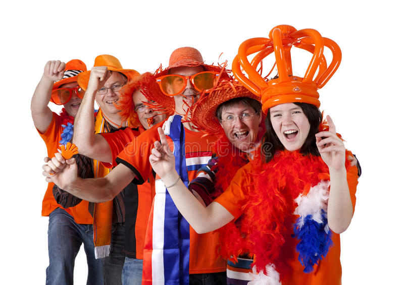 Group of Dutch soccer fans making polonaise over white background stock photography