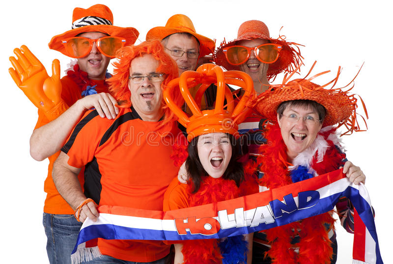 Group of Dutch soccer fans over white background royalty free stock images