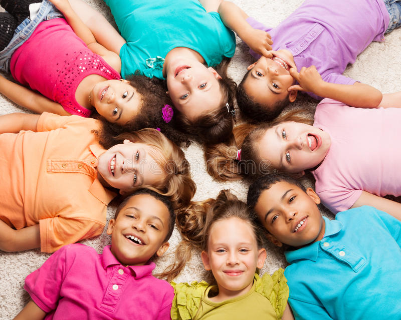 Group of eight happy kids in star shape stock photos