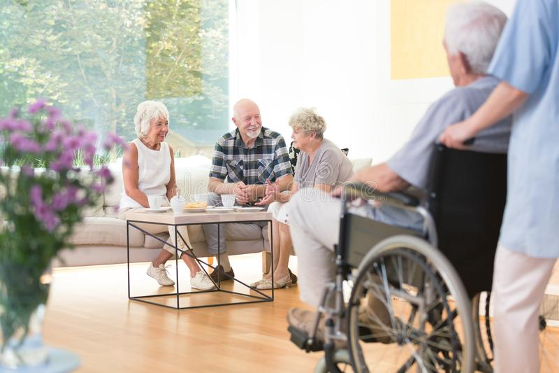 Elderly people in common room royalty free stock photos