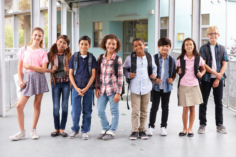 Group of elementary school kids hanging out at school royalty free stock image