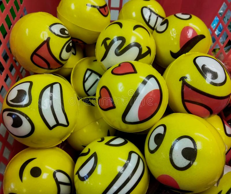 A Variety Of Emoji Faces On Yellow Balls In A Basket At A Novelty Store In New Jersey, Editorial Use. A group of emojis with different faces, happy, sad royalty free stock photography