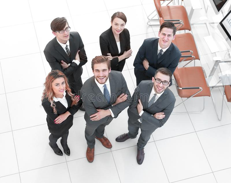 Group of employees looking at the camera. View from the top .a group of employees looking at the camera.business concept royalty free stock photography