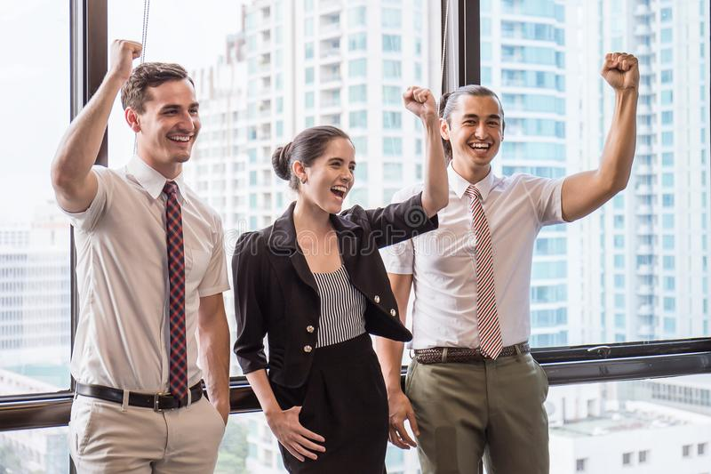 Group of employees with their hands holding together and having fun in the business meeting stock photo