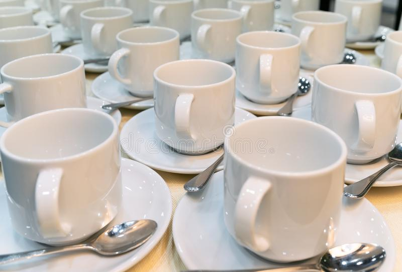 Group of empty coffee cups. Many rows of white cup for service tea or coffee in breakfast stock image