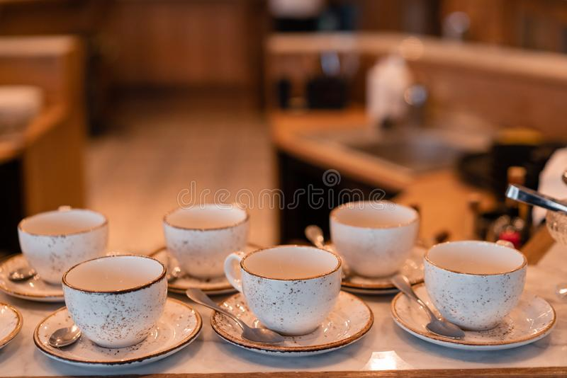 Group of empty cups in many rows of a white cup for coffee in breakfast and seminar event. designed in vintage retro stock photos