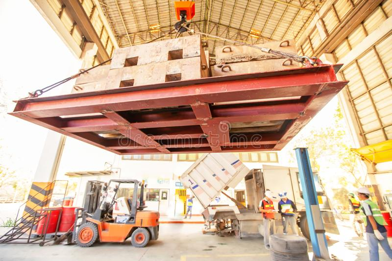 Hoist iron hook lifting of structure platform in a factory royalty free stock photo