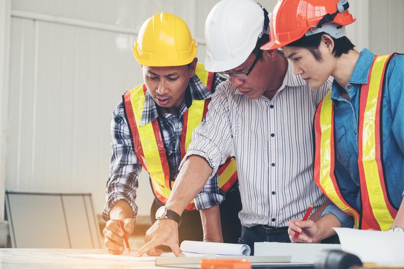 Group engineers and architects are discussing the construction download group engineers and architects are discussing the construction stock photo image of business malvernweather Images