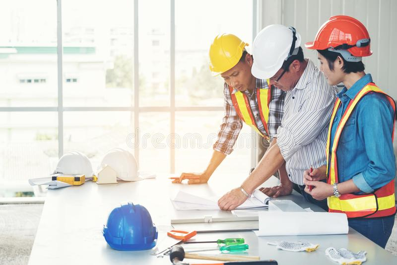 Group engineers and architects are discussing the construction. stock photo