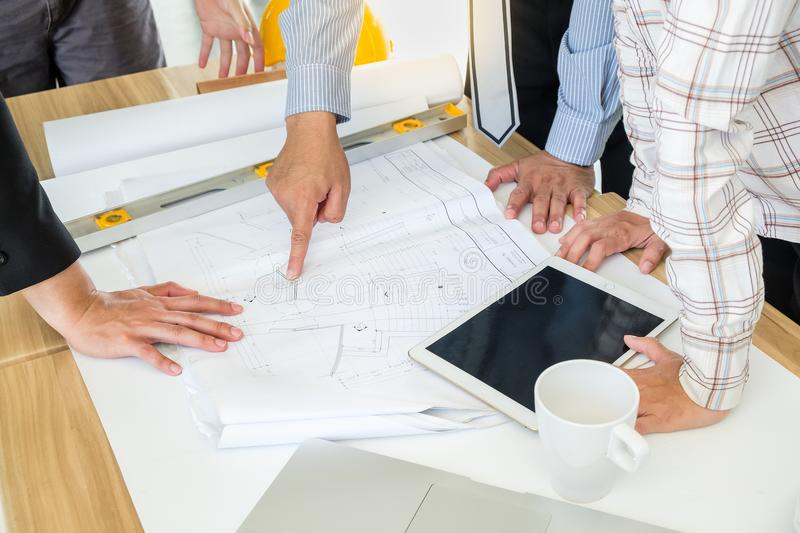 A group of engineers are looking at a blueprint for construction royalty free stock photos