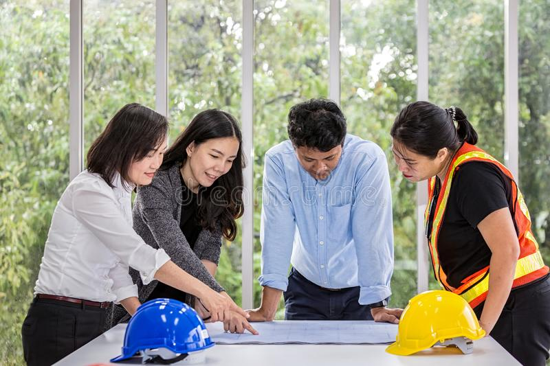 Group engineers working meeting room at the office. Team workers are talking construction plan. Electricians carpenter or royalty free stock photos