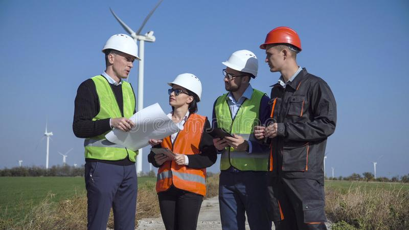 Group of people creating windmill project stock photo