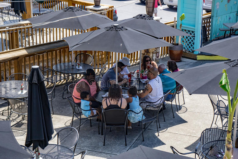 Group Enjoying Lunch at Smith Mountain Lake, Virginia, USA. Franklin County, VA – May 14th: Group of adults enjoy lunch at an outdoor restaurant at royalty free stock photos