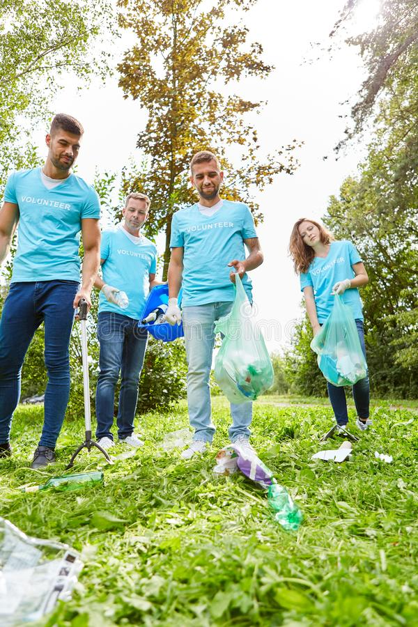 Group of environmentalists collects garbage. Group of volunteer environmentalists and volunteers collect garbage in nature stock photography