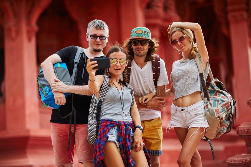 Group of european tourists taking group selfie at buddhist temple in thailand royalty free stock image