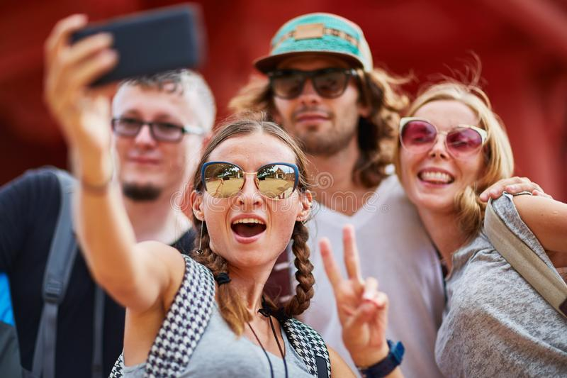 Group of european tourists taking group selfie at buddhist temple in thailand royalty free stock photography