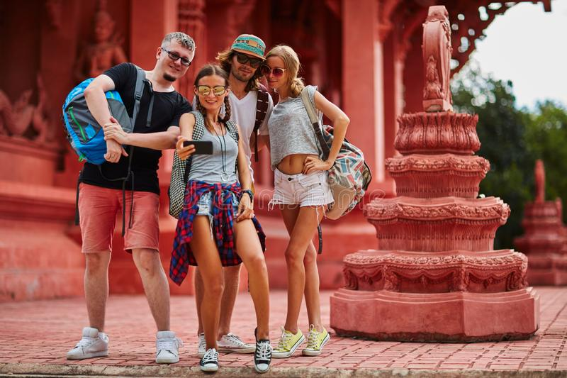 Group of european tourists taking group selfie at buddhist temple in thailand royalty free stock photo