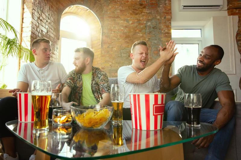 Group of excited friends playing video games at home royalty free stock photo