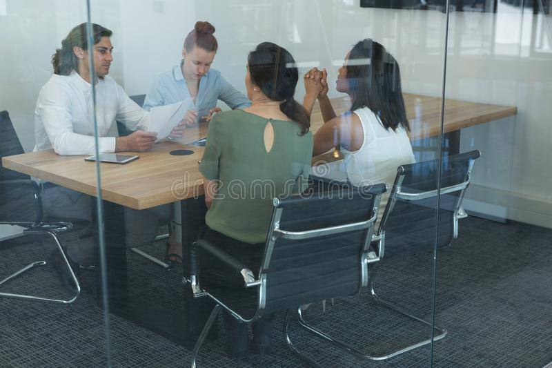 Group of executives discussing while working at the desk stock photo
