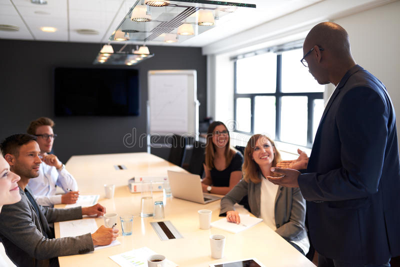 Group of executives sitting in conference room stock photography