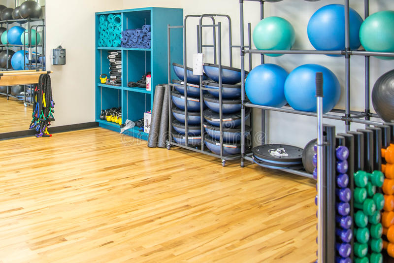 Group exercise room with workout equipment stock image