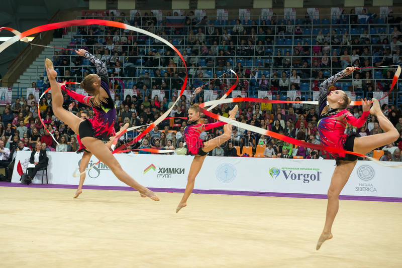 Group exercises, the team of Latvia. MOSCOW, RUSSIA - FEBRUARY 19, 2016: group exercises, the team of Latvia on Rhythmic gymnastics Alina Cup Grand Prix Moscow royalty free stock image